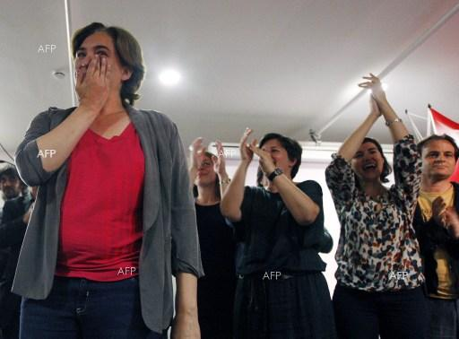 Ada Colau, leader of the protest movement of the Indignados, wins local elections in Barcelona.