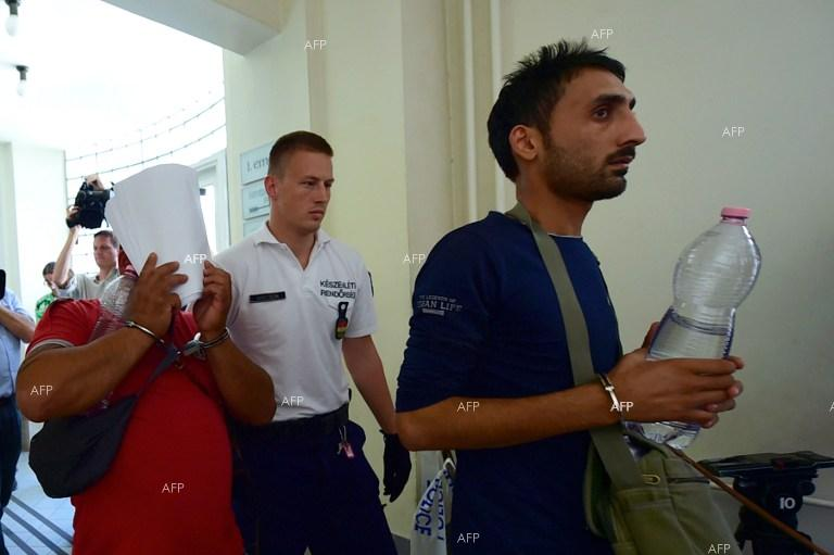Three Bulgarians and an Afghan appear in a Hungarian court over the death of 71 migrants found in a truck in Austria.