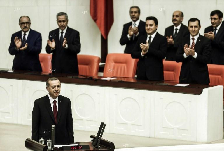 Recep Tayyip Erdogan officially takes office as Turkish President.