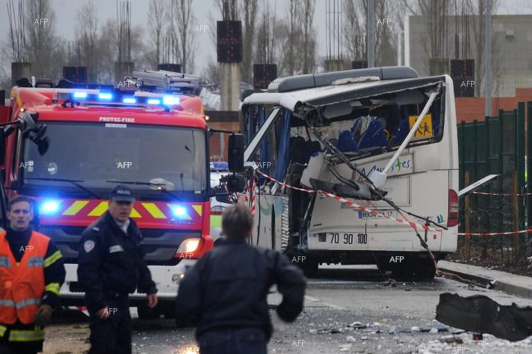 Six killed as a school minibus crashes with a truck in France.