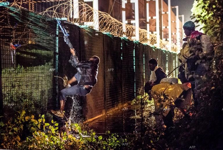 Migrants again storm the Channel Tunnel.