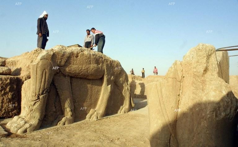Jihadists bulldoze the ancient city of Nimrud in Iraq.
