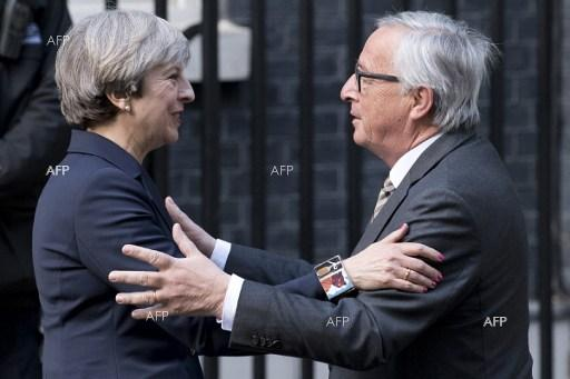 European Commission President, Jean-Claude Juncker (R) is greeted by British Prime Minister Theresa May outside 10 Downing Street in London on April 27, 2017.