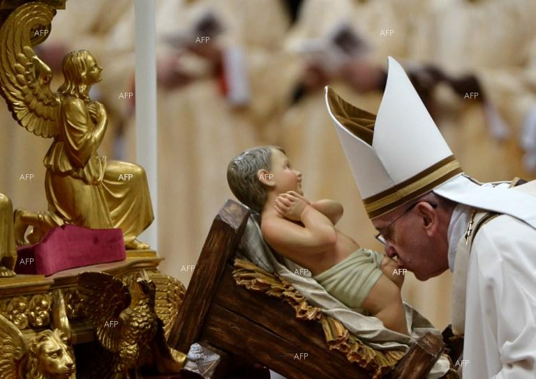 Pope Francis. Christmas Eve Mass. Vatican City, St. Peters Basilica.