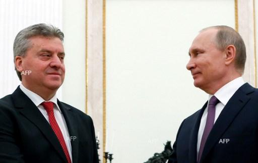 Russian President Vladimir Putin (R) shakes hands with his Macedonian counterpart Gjorge Ivanov during a meeting at the Kremlin in Moscow on May 24, 2017.