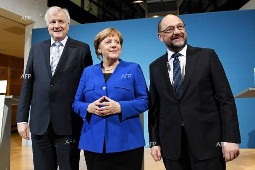 Horst Seehofer, Angela Merkel and Martin Schulz after a 24-hour round of talks on a new grand coalition. January 12, 2018;