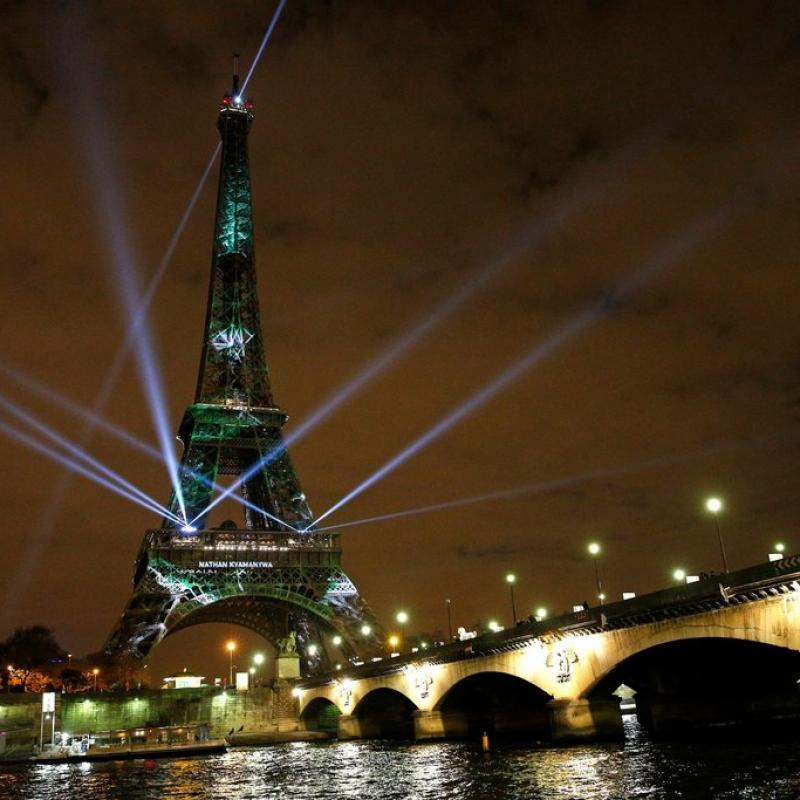 The Eiffel Tower lit up in green for the start of the Paris climate conference.
