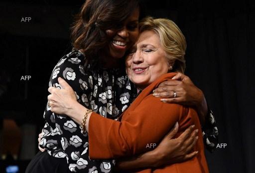 US First Lady Michelle Obama hugs with president candidate Hillary Clinton during a campaign meeting. October 28, 2016.