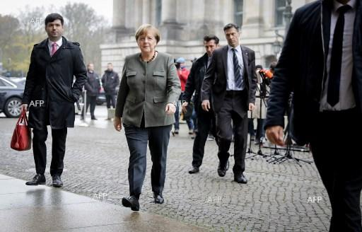 AFP: Merkel party, Social Democrats reach 'breakthrough'
