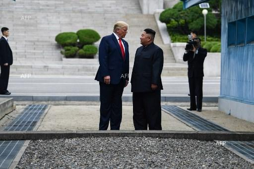 Donald Trump and North Korean leader Kim Jong Un meet at the Korean Demilitarized Zone. June 30, 2019