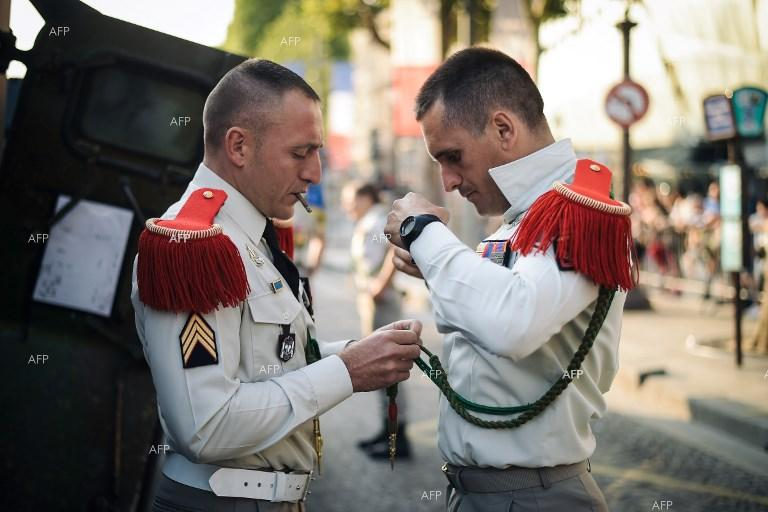 French soldiers prepare for parade on Bastille Day. July 14, 2018;