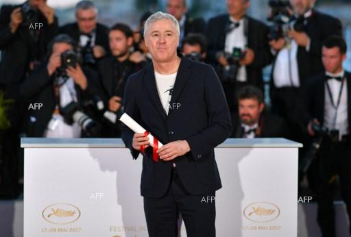 "French director Robin Campillo poses during a photocall after he won the Grand Prix for the film ""120 Beats Per Minute"" at the 70th edition of the Cannes Film Festival in Cannes, southern France. May 29, 2017."