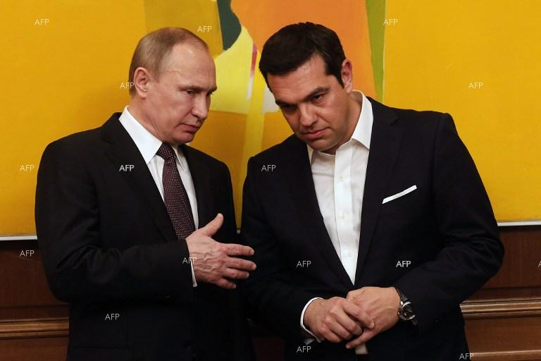 Greek Prime Minister Alexis Tsipras  talks with President of the Russian Federation Vladimir Putin during their meeting in Athens.