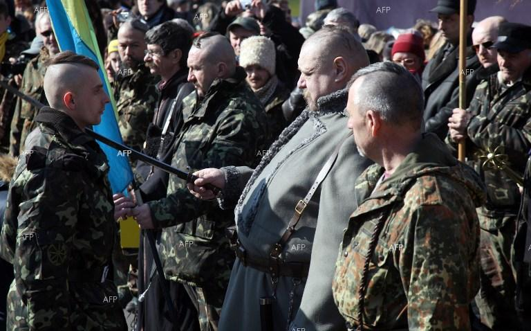 Ukrainian Cossack swears in at the Independence Square in Kiev.