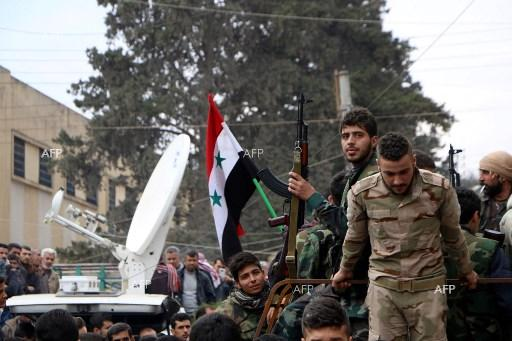 Syria's Assad visits Eastern Ghouta troops in rare 'front line' visit