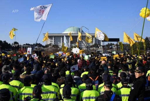 Protestors in front of the National Assembly building in Seoul, South Korea, call for he impeachment of President Park Geun-hye. December 9, 2016.