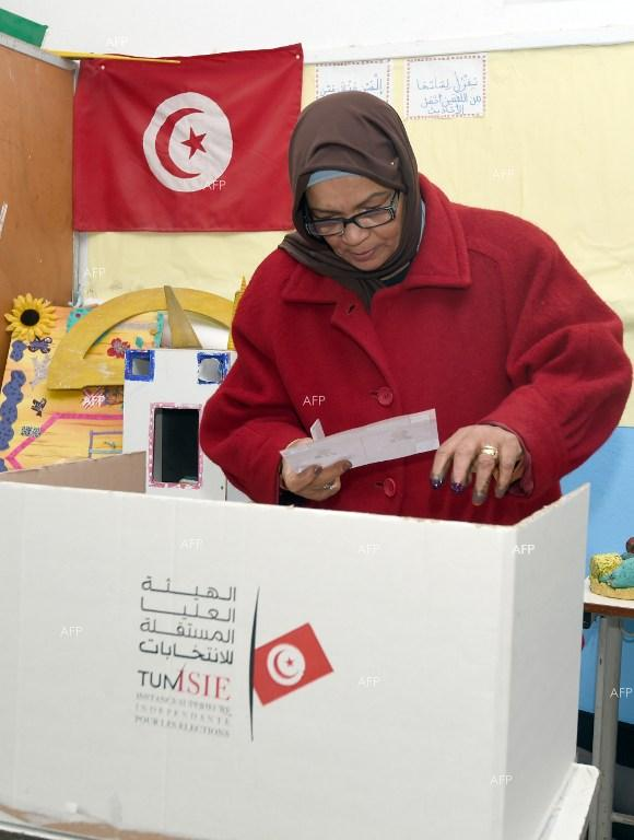 Tunisians vote for post-revolution president.