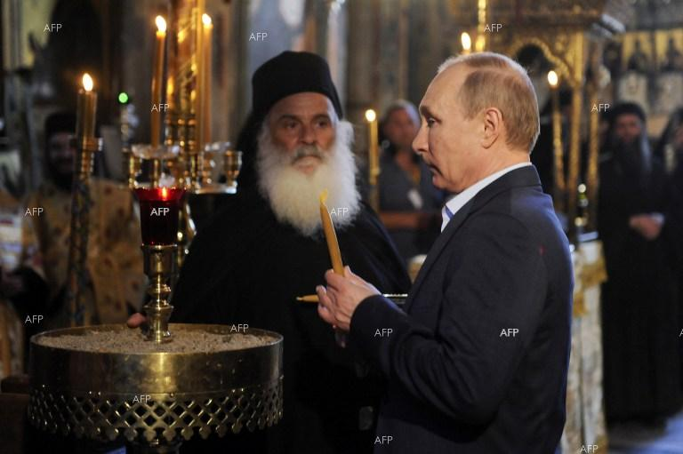 Russian President Vladimir Putin on Saturday visited the monastic community of Mount Athos on the last leg of a two-day visit to Greece.