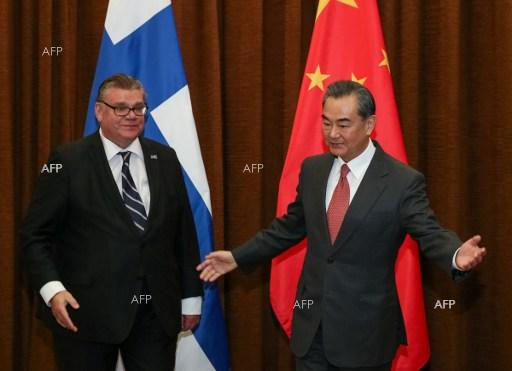 Chinese Foreign Minister Wang Yi (R) and Finish Foreign Minister Timo Soini (L) during their meeting at the Ministry of Foreign Affairs in Beijing on February 27, 2017.