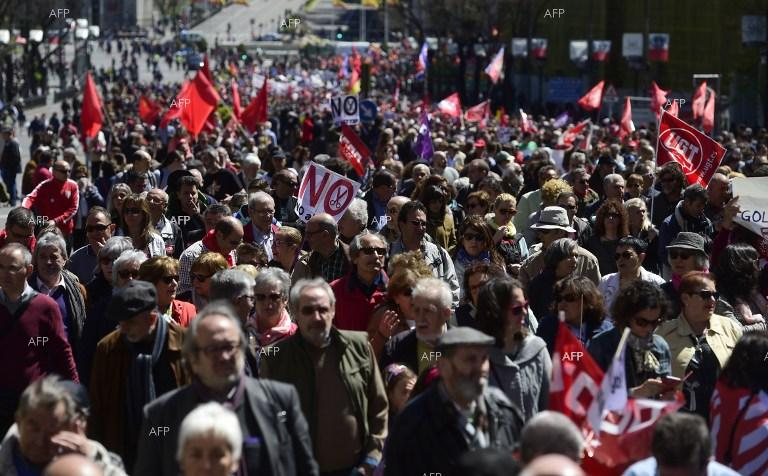 Thousands of people join May 1 rally in Madrid.