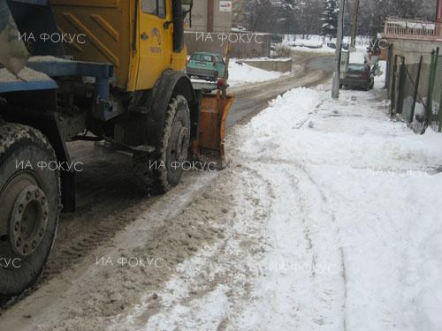 Snow removal teams in Sofia treating high and steep places against icing