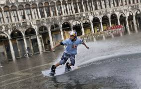 Man rides his wakeboard through the flooded Piazza San Marco in Venice. November 14, 2019