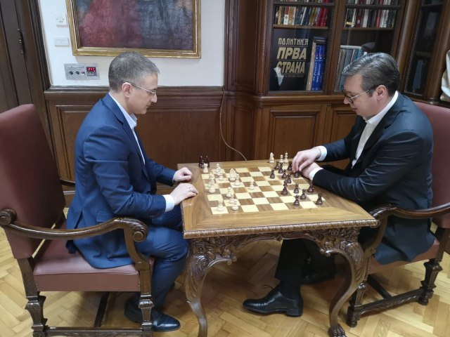Vucic playing chess with Serbian interior minister amid protests in front of presidential palace. March 17, 2019;