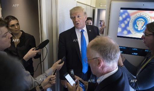 Donald Trump speakes to reporters during the flight to the US after his visit to Asia. November 14, 2017;