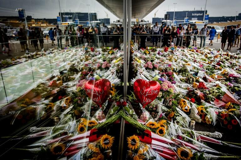 Dutch people leave flowers at Amsterdam Airport Schiphol to honour the memory of MH17 flight victims.