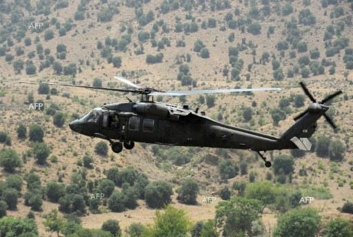 The Daily Express: US military helicopter 'crashes on Iraq-Syria border' Seven people on board
