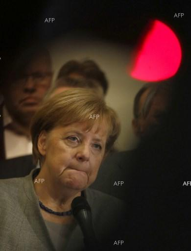 Angela Merkel: 'Big obstacles' still in way of Germany coalition deal