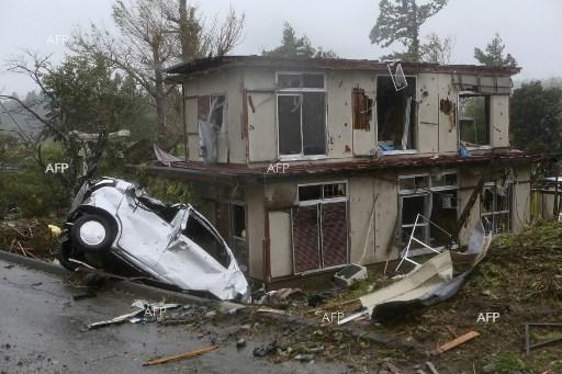 AFP: Japan rescuers seek survivors after Typhoon Hagibis kills 35