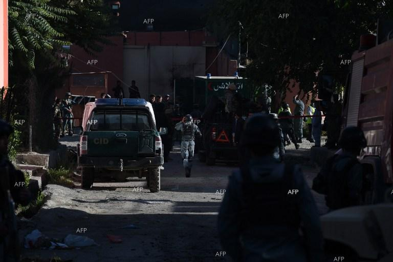 Afghan police guard hotel in diplomatic quarter of Kabul, which was target of Taliban attack.