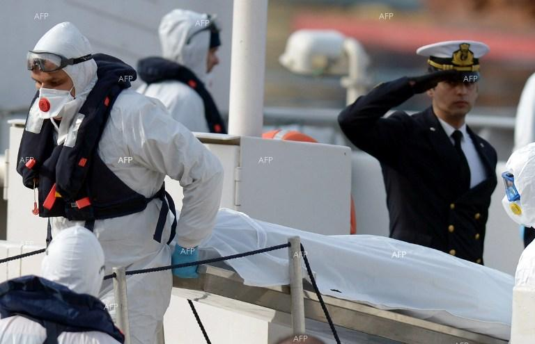 Italian rescue teams carry bodies of Mediterranean shipwreck victims.