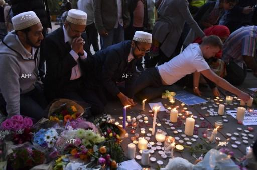 People light candles and pray for the victims of the terrorist attack in Manchester. May 24, 2017