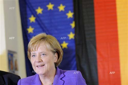 AFP: Merkel congratulates Macron on 'clear parliamentary majority'