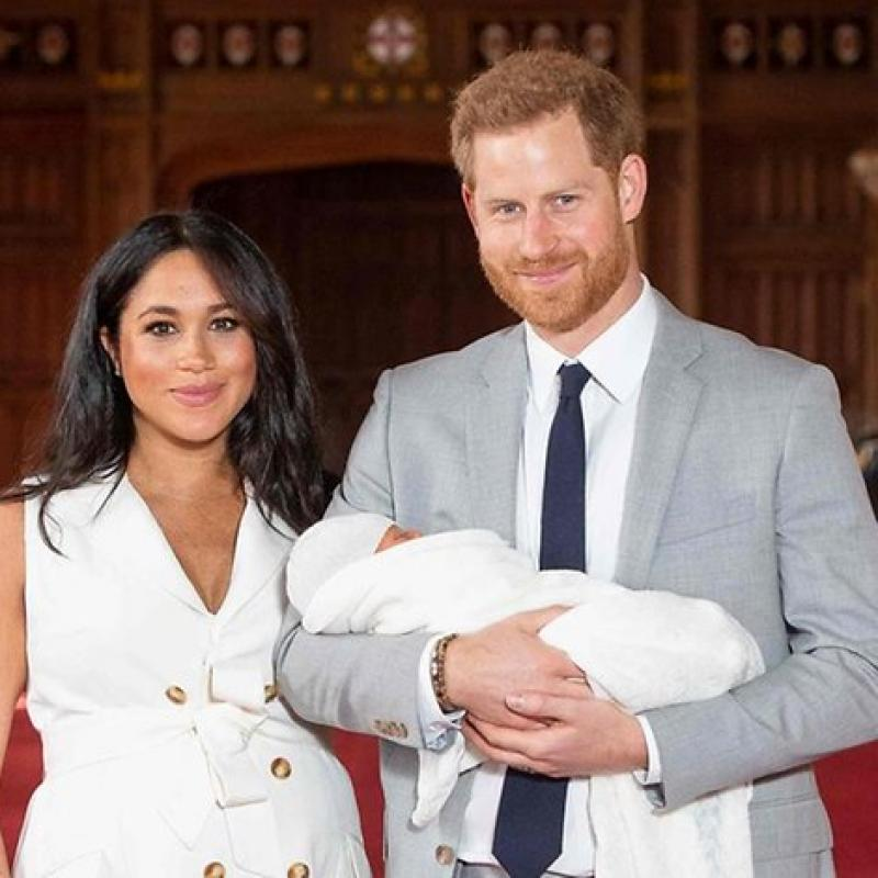 Prince Harry and Meghan show off their newborn son.